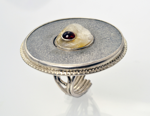 Sterling silver ring with washer, a piece of quartz Jeff found on the Rail Trail set with a garnet.