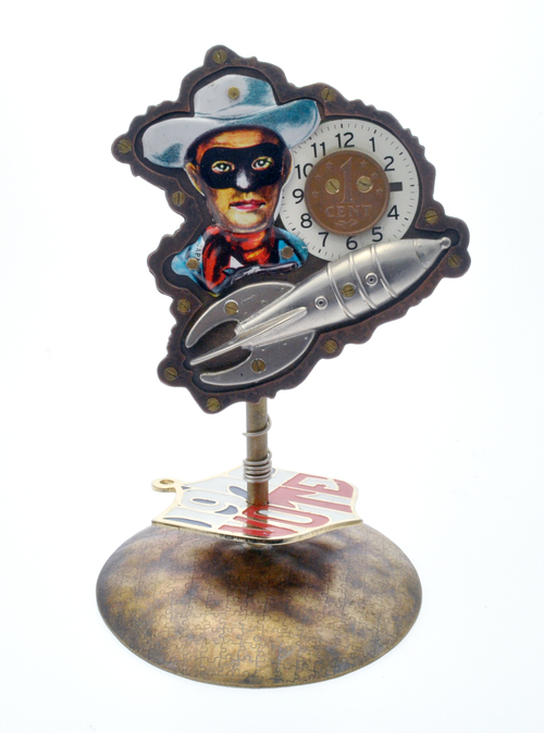 """Brooch on a stand. Made in the Radical Jewelry Makeover Project of many different materials """"mined"""" from donated jewelry, 2014.   (click on photo to enlarge)"""