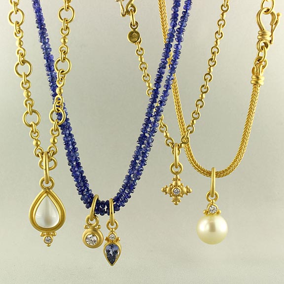 Necklaces of handmade chains and sapphire beads with pendants of aquamarine, diamonds, sapphire and pearl