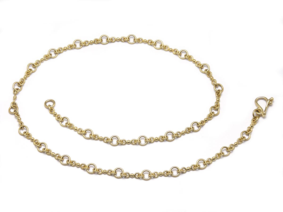 Handmade chain, starting with a granule of 22 karat gold and adding pieces to make links and then adding jump rings to connect links