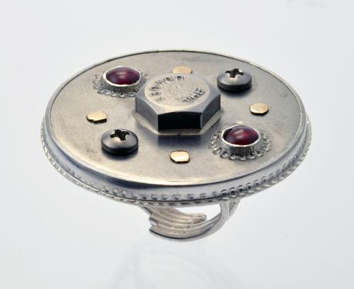 Sterling silver ring with stainless steel, 14 karat yellow goldand garnet