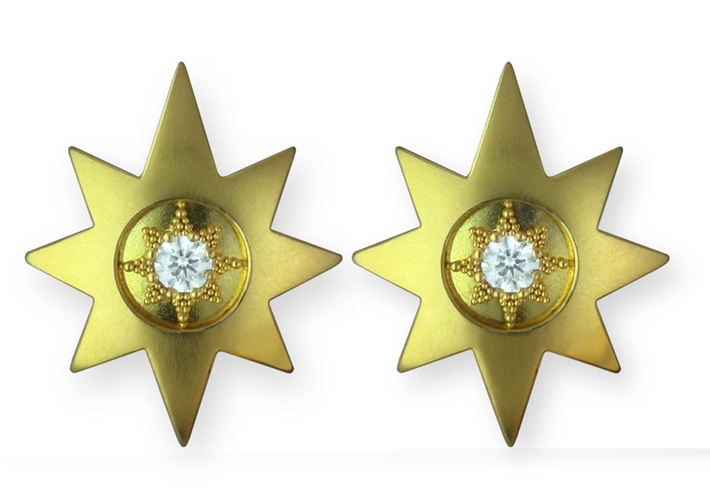 18 karat yellow gold star earrings with 22 karat granulation and white diamonds.