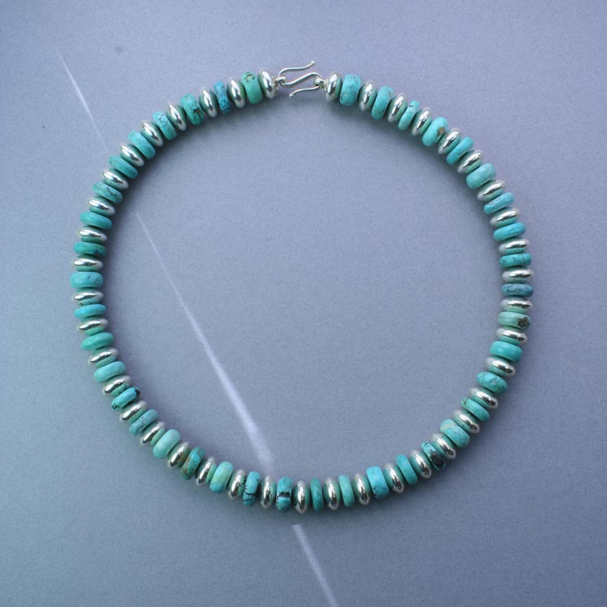 Turquoise and Sterling Silver Necklace. The sterling silver beads and catch are hand made.