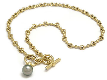22 karat yellow hand made chain with flawless natural color Tahitian pearl.