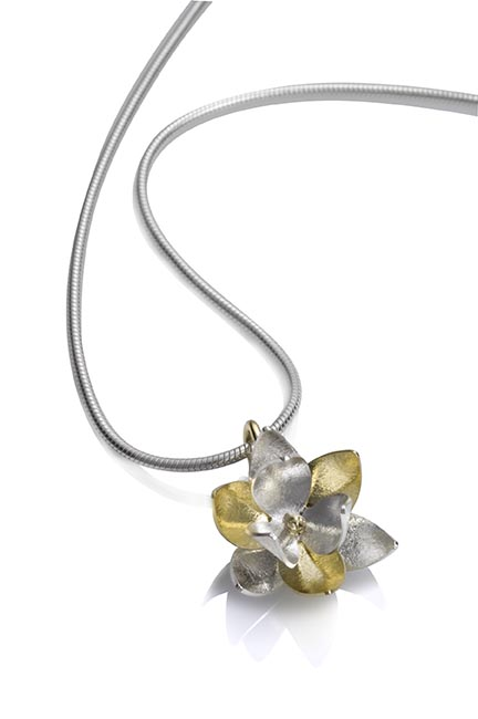 Sterling silver chain and Lotus Pendant of sterling silver and 18 karat yellow gold.