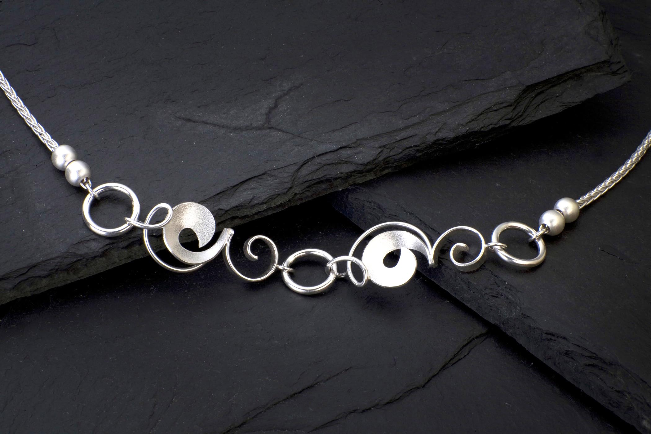 """Sterling silver necklace """"Pea Vines and Circles"""" with two fresh water pearls on each side."""