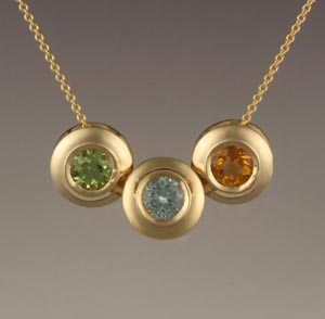 "Paul Gross, ""Family Necklace"" in 14 karat yellow with peridot, aqua and citrine."