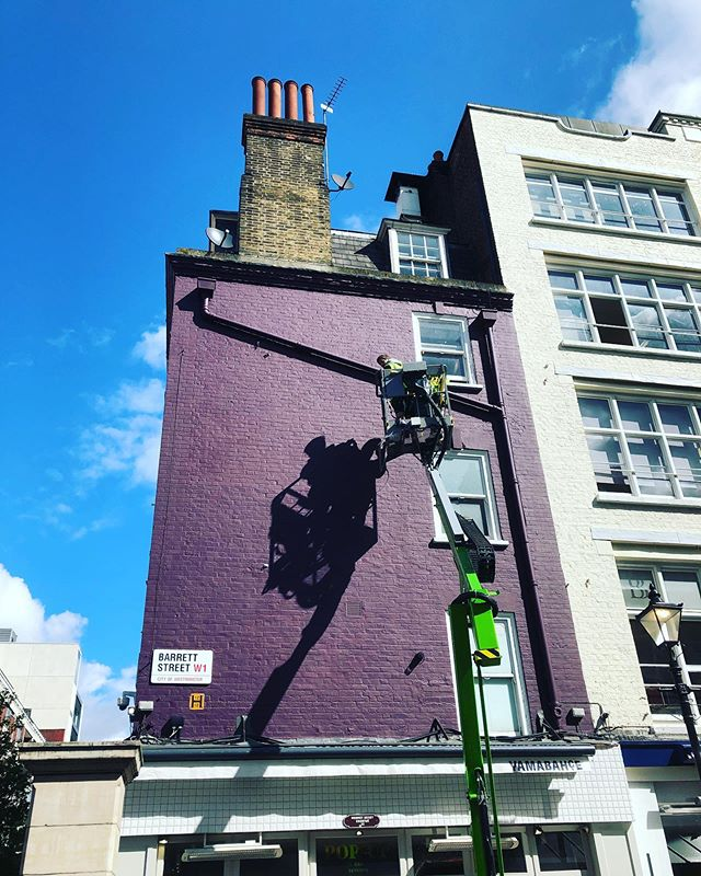 Up the cherry picker in central London this week - hoping the weather stays like this! #breadcollective #signpainting #alwayshandpaint #mural #london #stchristophersplace #lookslikerain #purplerain