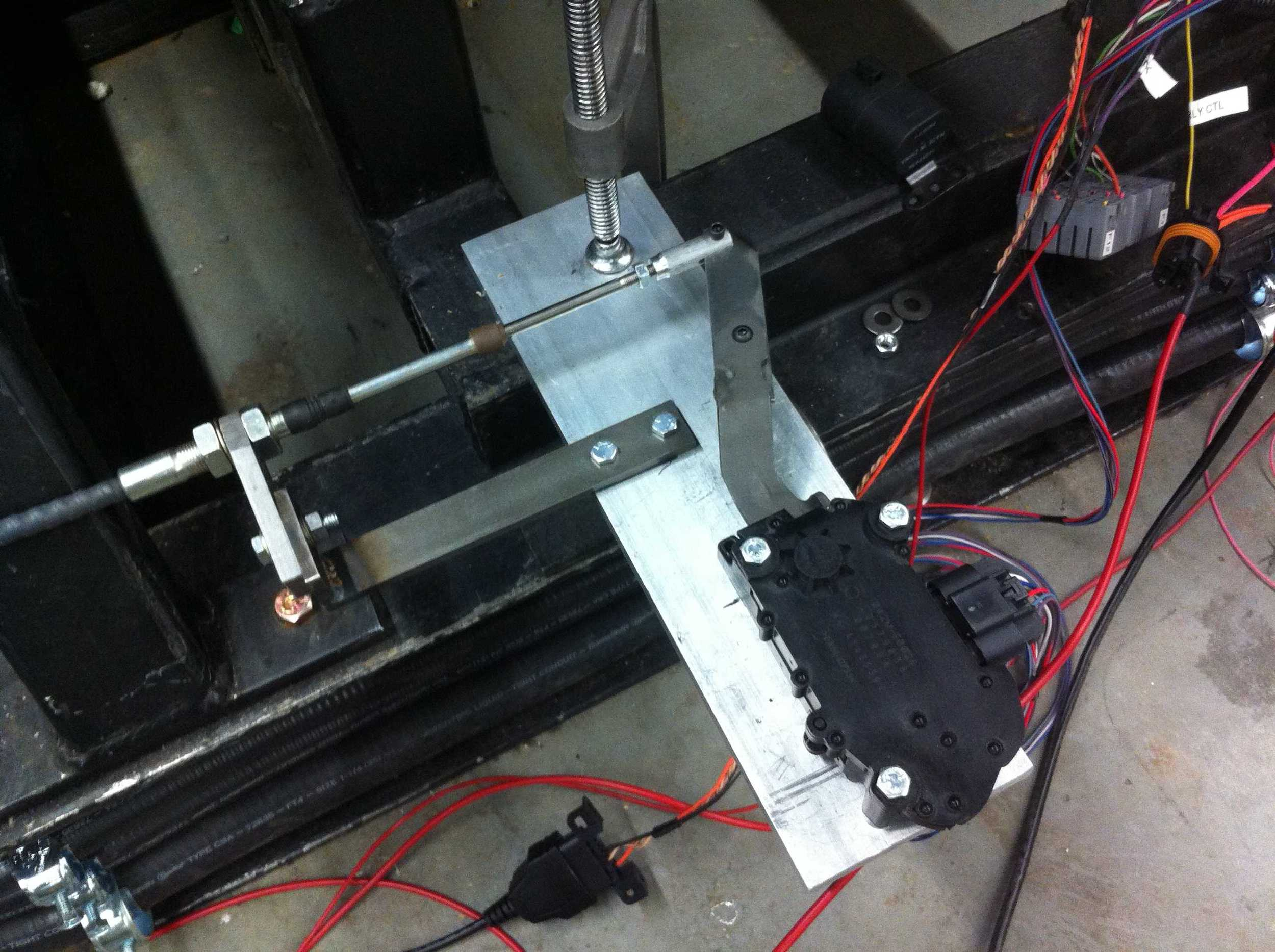 Custom pedal mount for the dyno actuator.