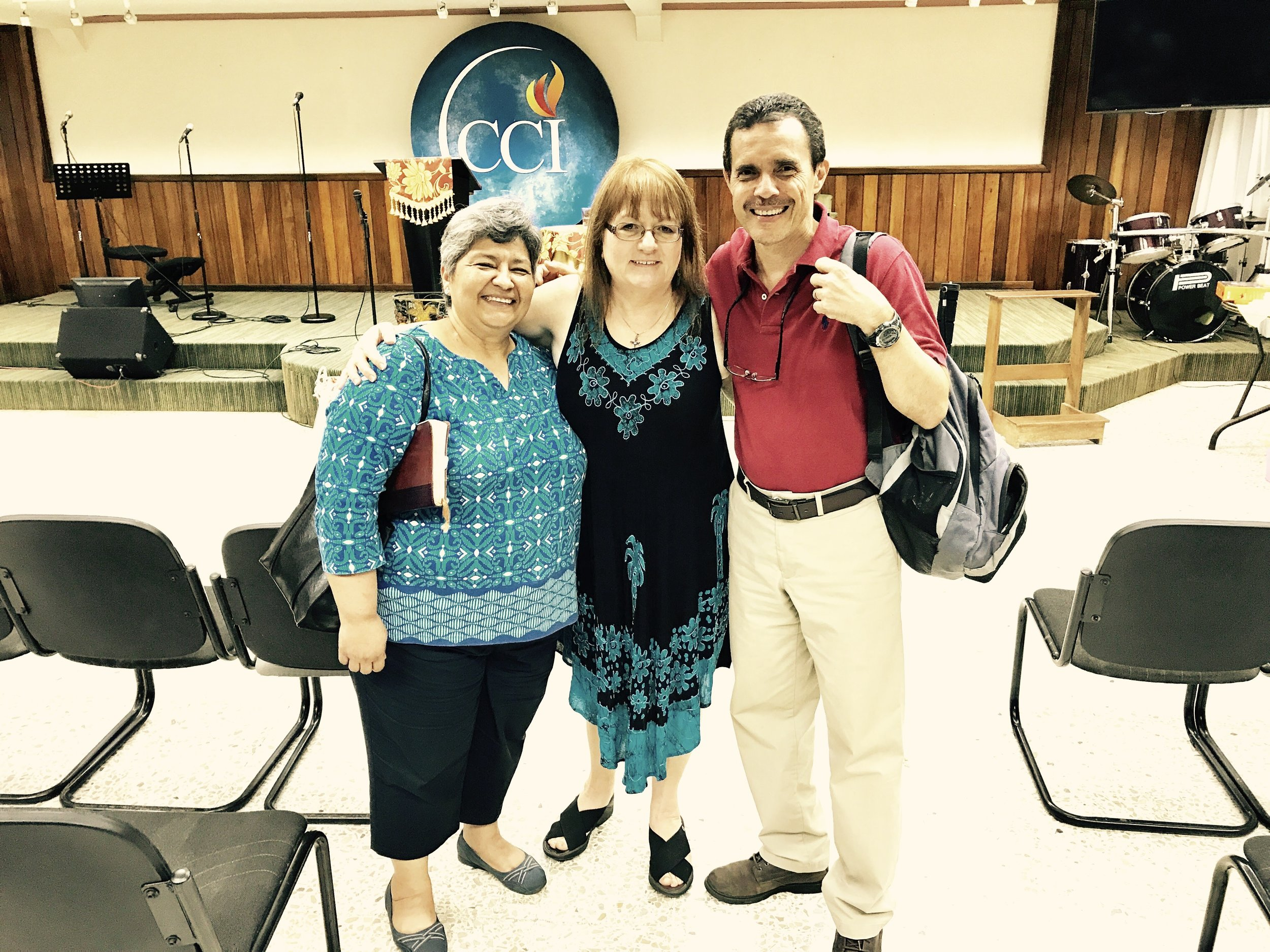 Betty Moffitt with a couple from La ceiba after the night service.