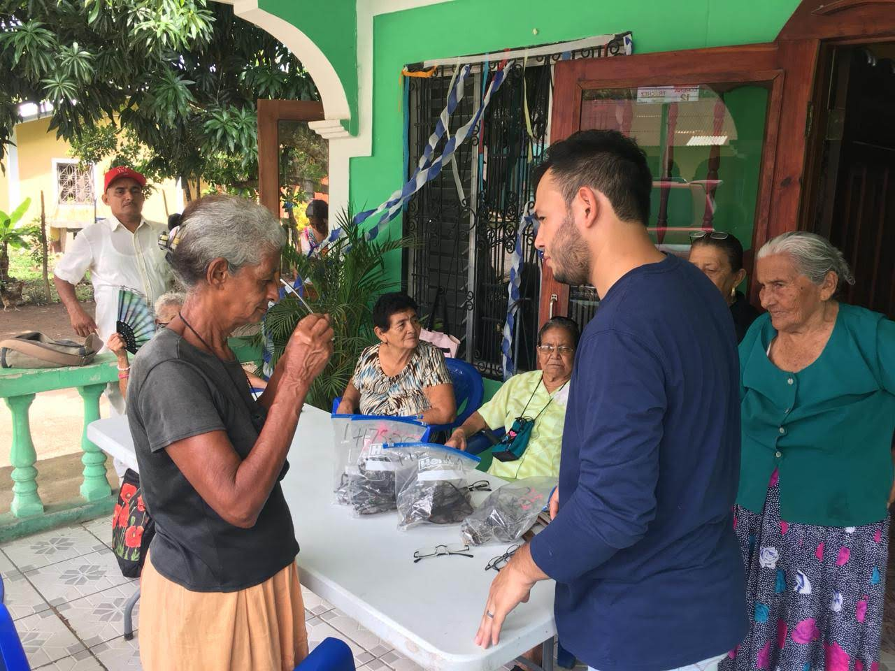 Individuals receive new glasses donated to Connect Global in Honduras.