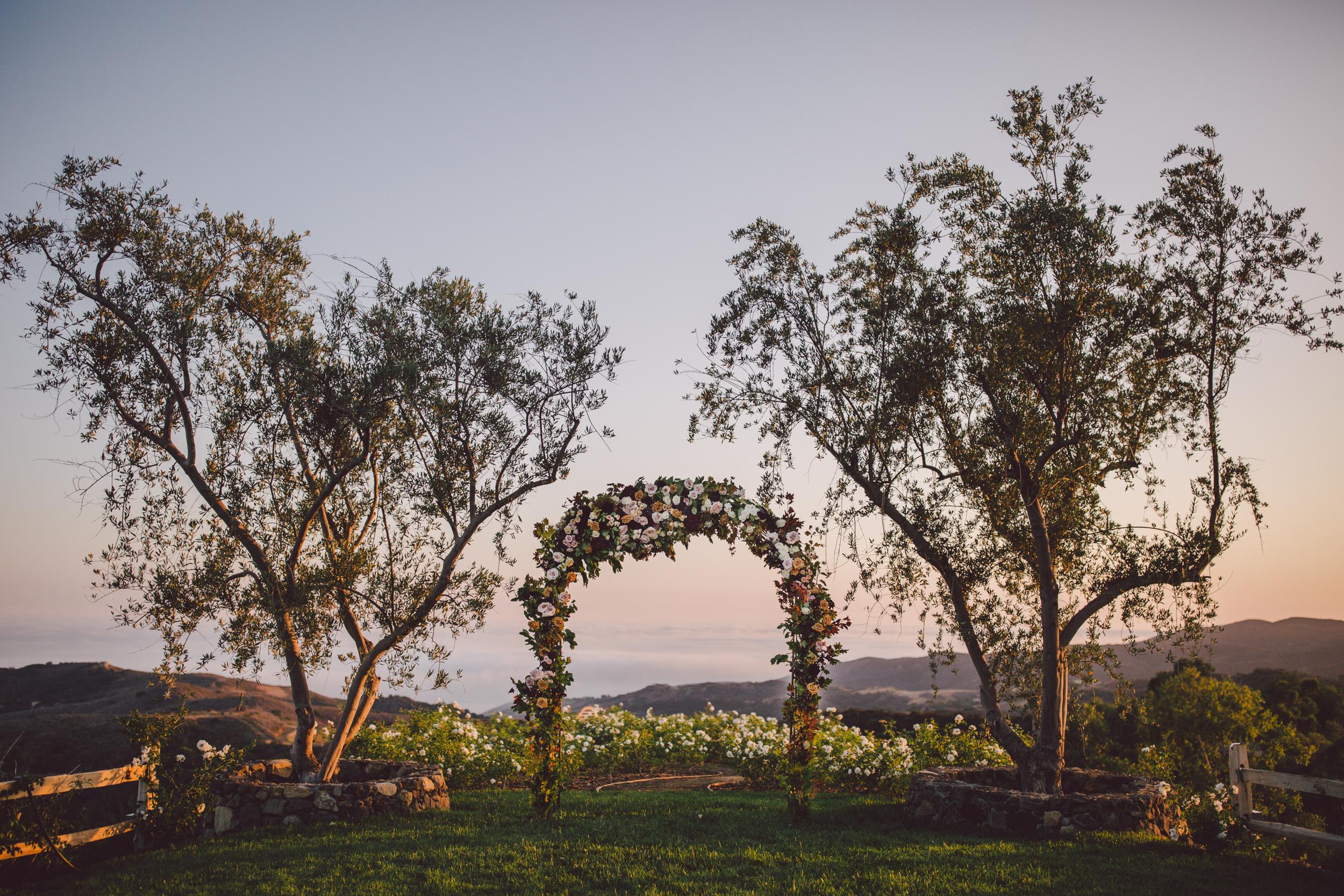 romantic-boho-stonewall ranch-malibu-sunset-ceremony-floral arch