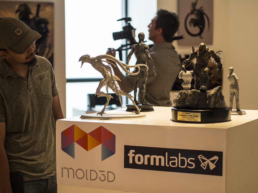 Attendee admiring the awesome Character maquettes and 3D Prints on display.
