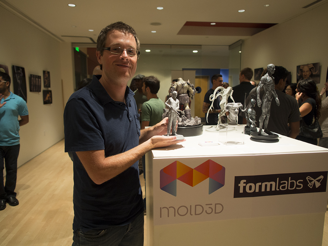 Proud artist Matheui Aerni holds the 3D Print of his character design.
