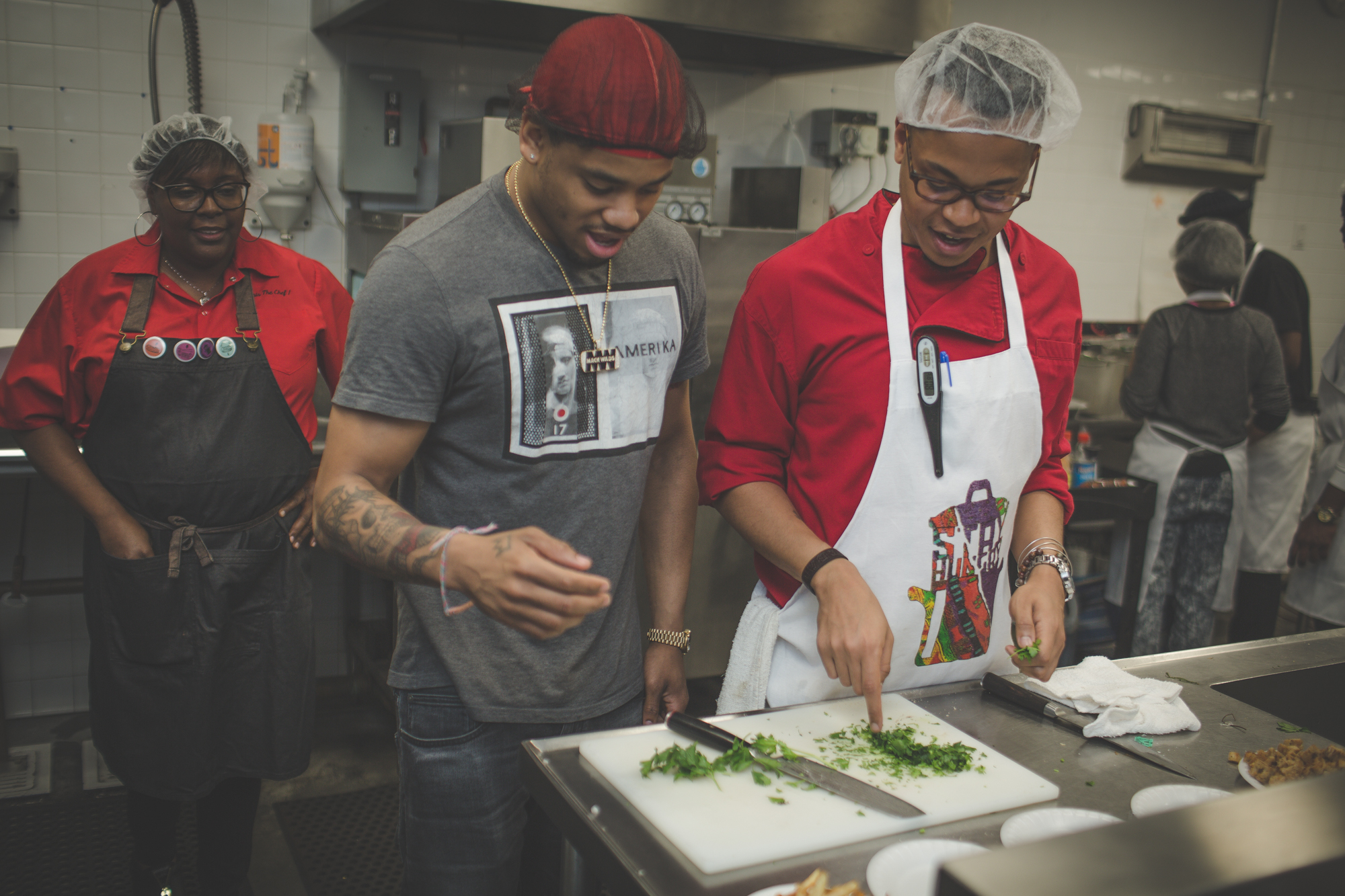 Mack Wilds getting cutting advice from Chef Cliff