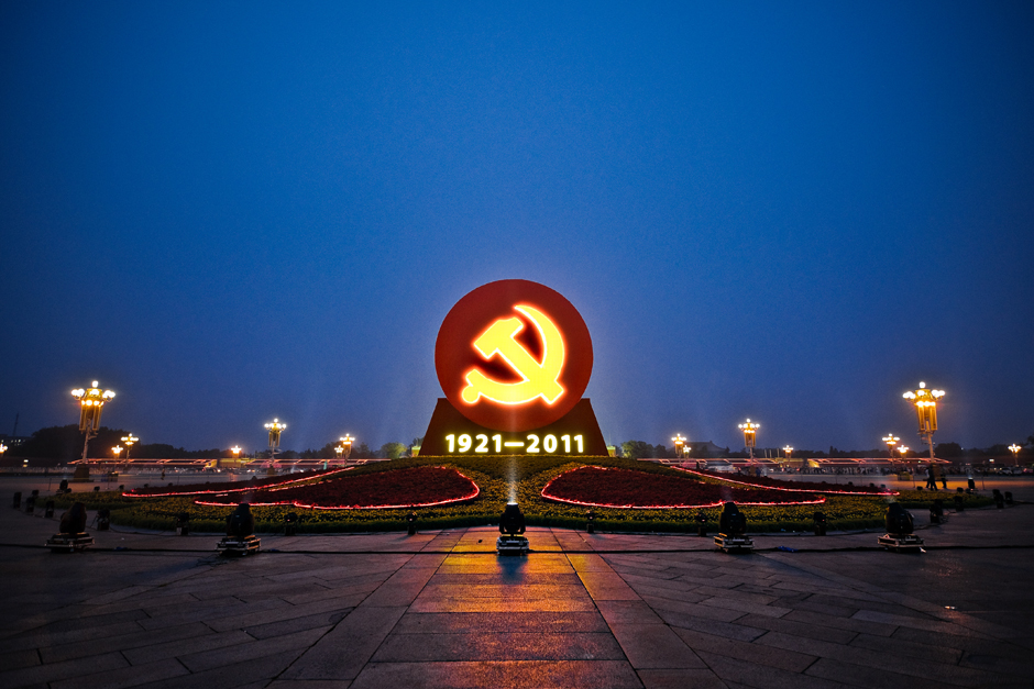Beijing ,  China . A memorial in the center of an empty Tiananmen Square at dusk, celebrates the 90th anniversary of the revolt against the Qing Dynasty that established the Republic of China.