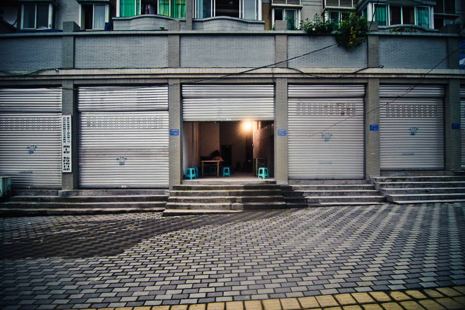 Chongqing ,  China . A shop sits empty in one of China's five national central cities. This is a rare sight in Chongqing whose population has swollen to nearly 30 million people.