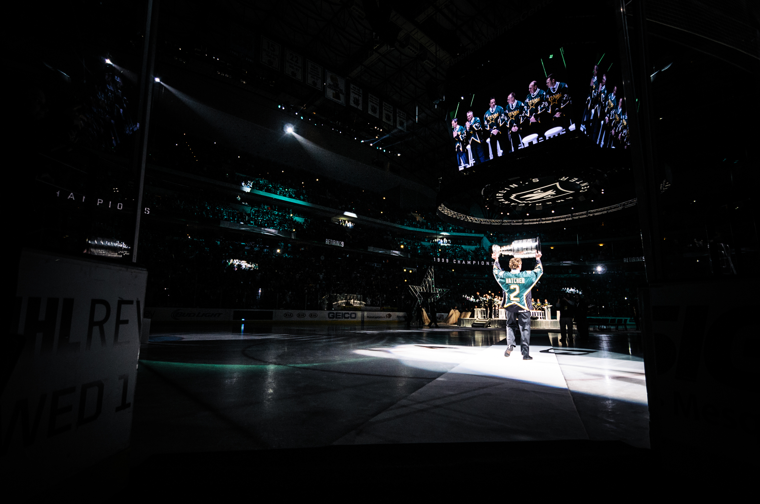 Derian Hatcher, captain of the '99 Stanley Cup winning Dallas Stars, carries The Cup into the arena to kick off the retirement of Mike Modano's number 9.
