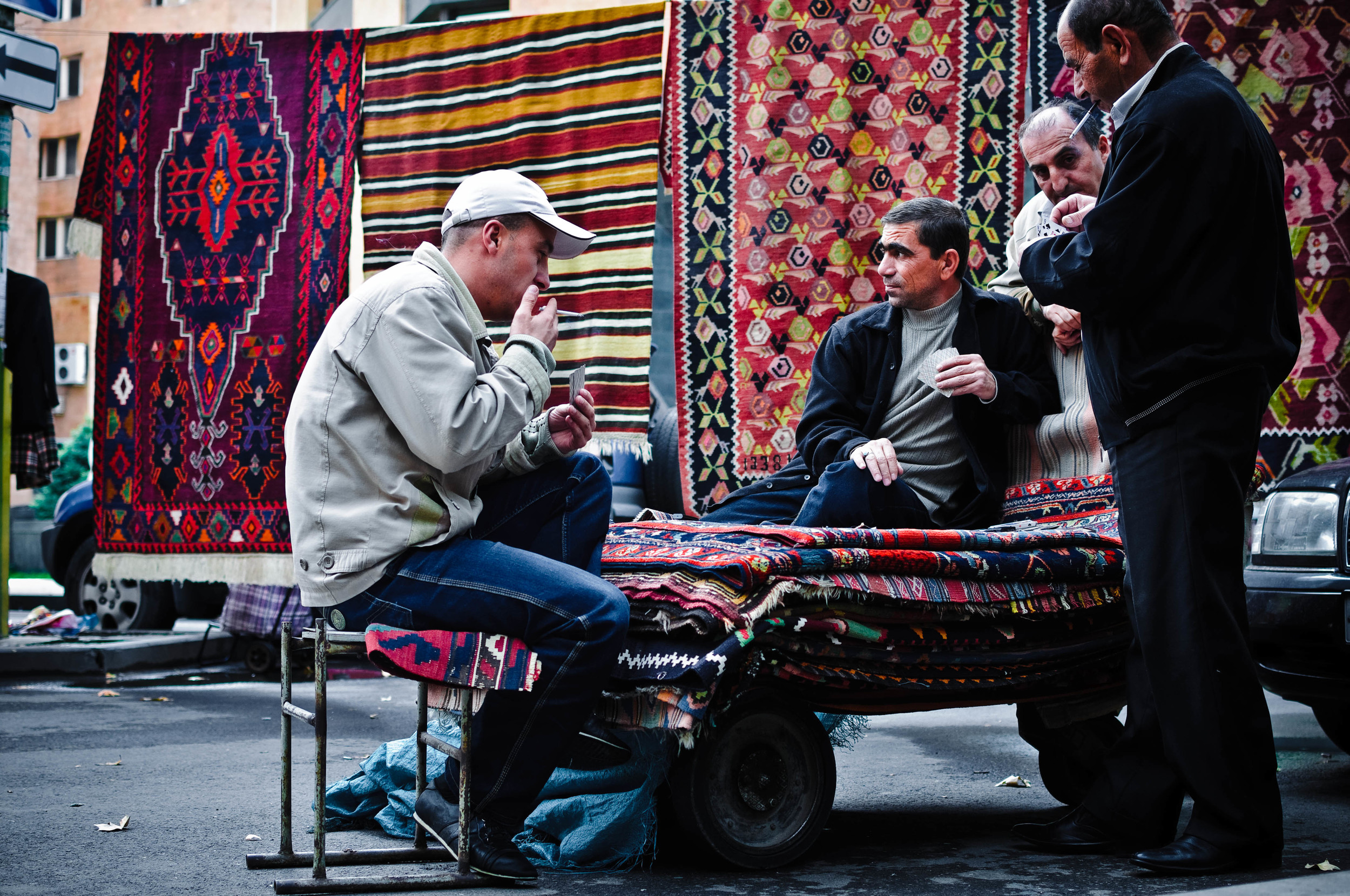 Armenian rug salesmen pass the time with a game of cards in the market.