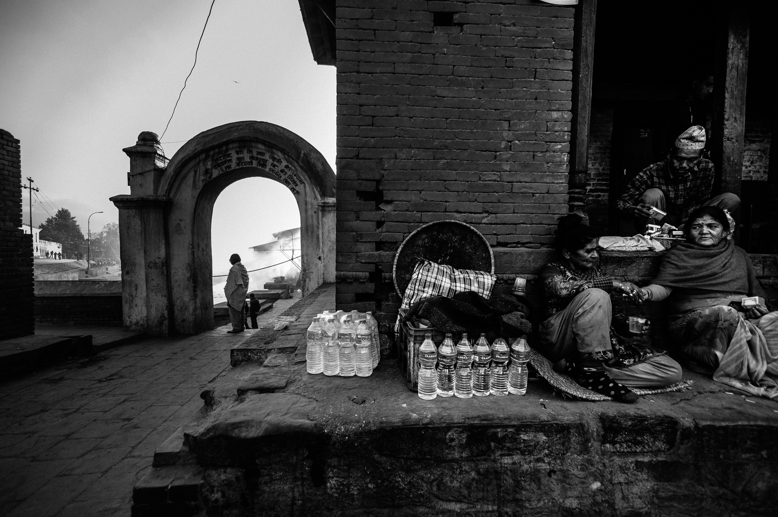 Temple vendors sell cigarettes, refreshments and items used in the burial ceremonies.