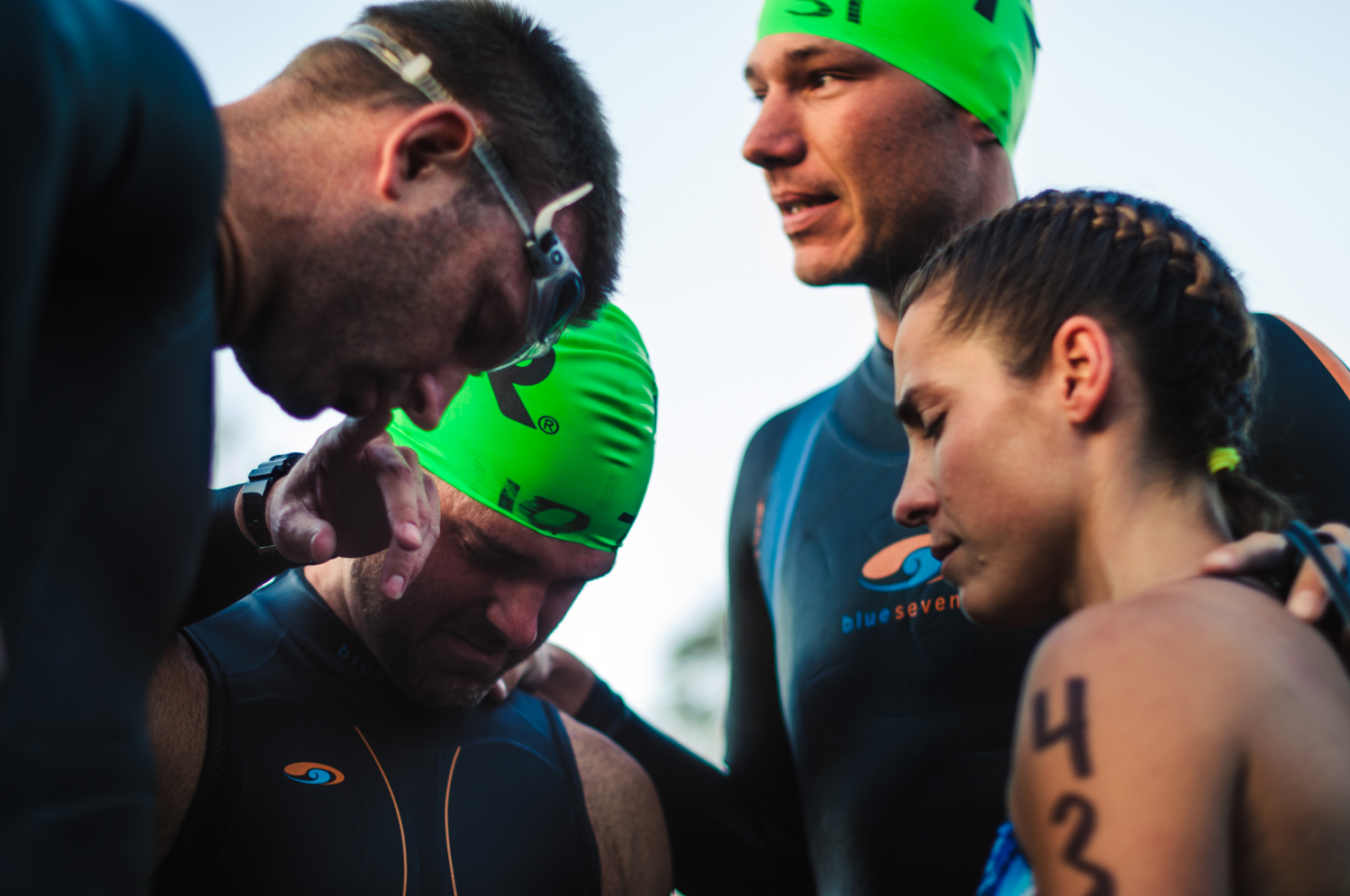 Jason's training partner Zack Mitchell (top right) led his friends in a prayer before entering the water.