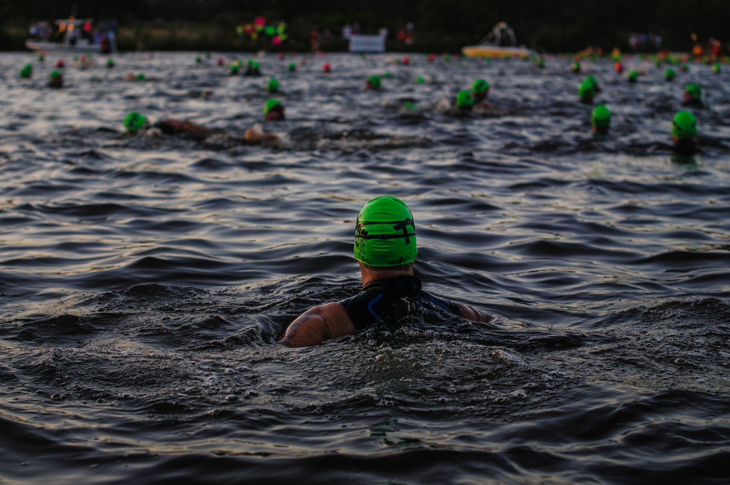 Prior to the start, the athletes warmed up in the wet-suit legal 68 ° water.