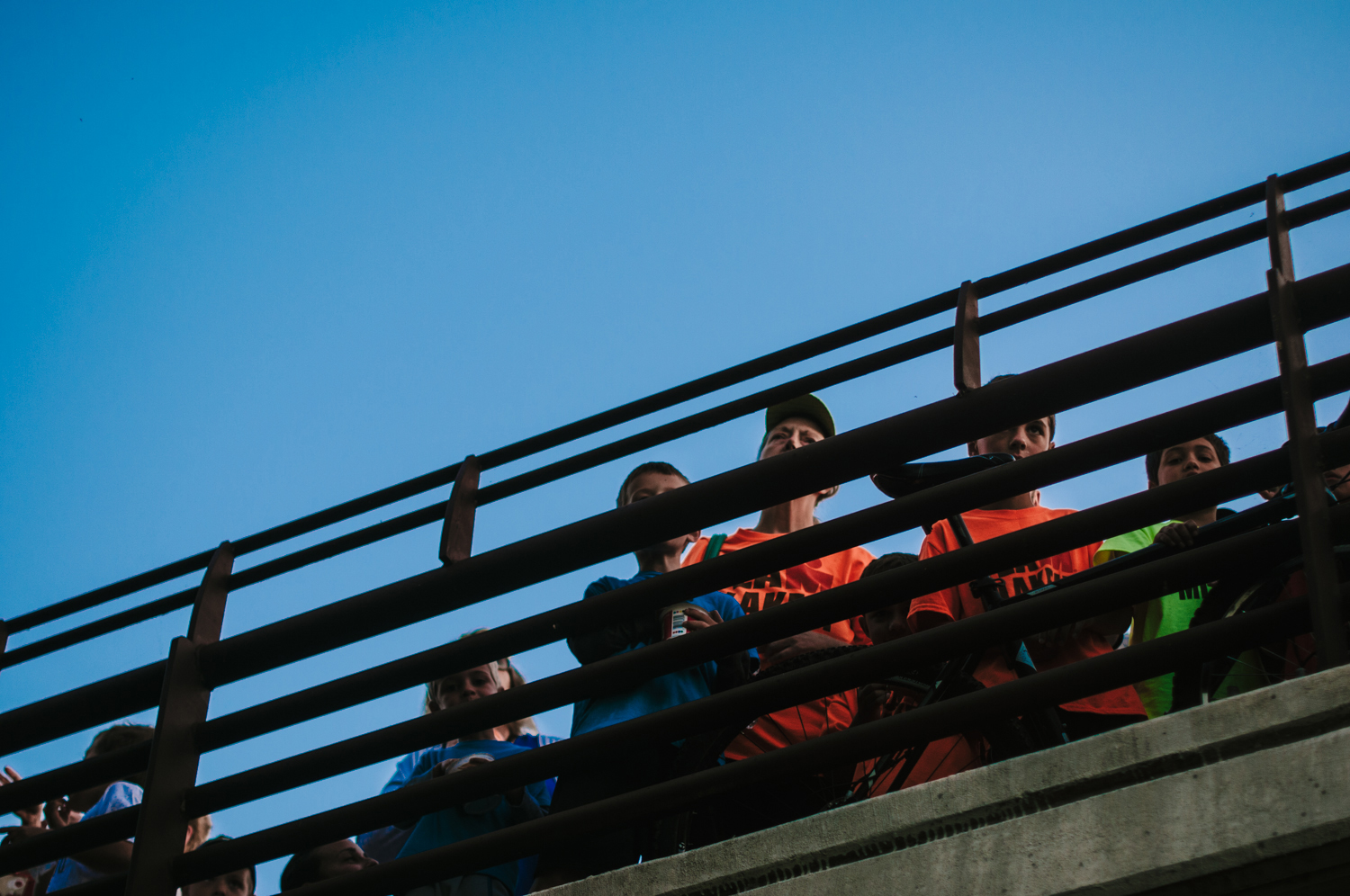 Jason's son, Reed, peeks through the railing of the bridge which provided spectators the best view of the starting line.