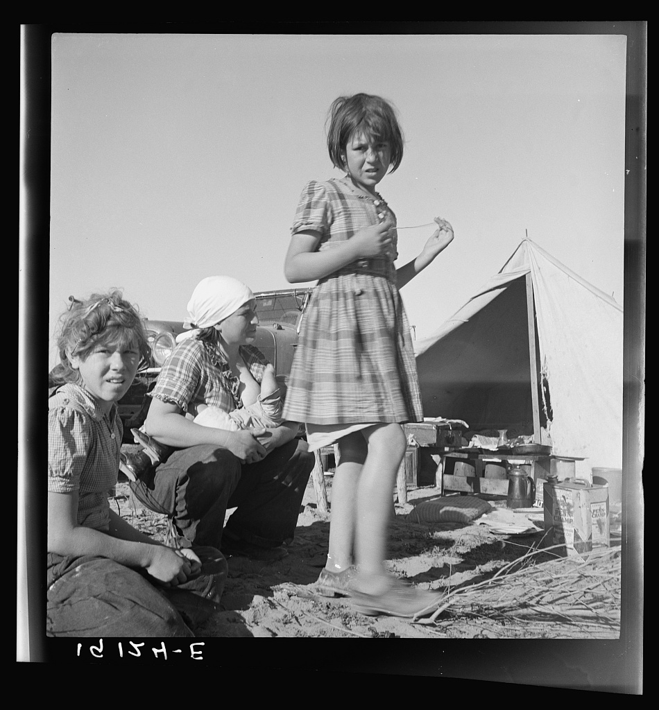 Part of family arrived the night before from Rockwell, Texas. Picked their way across the country. Encamped on the river bottom. Near Holtville. Imperial Valley, California.