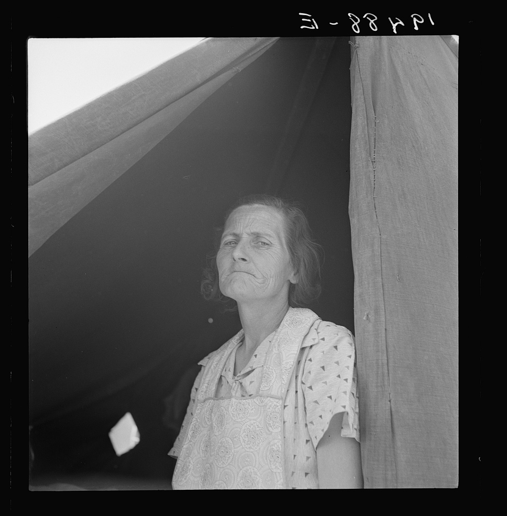 Migrant woman from Arkansas living in contractor's camp near Westley, California. She would prefer to live in a government camp, but the contractor system prevents, because of control over allocations of work.