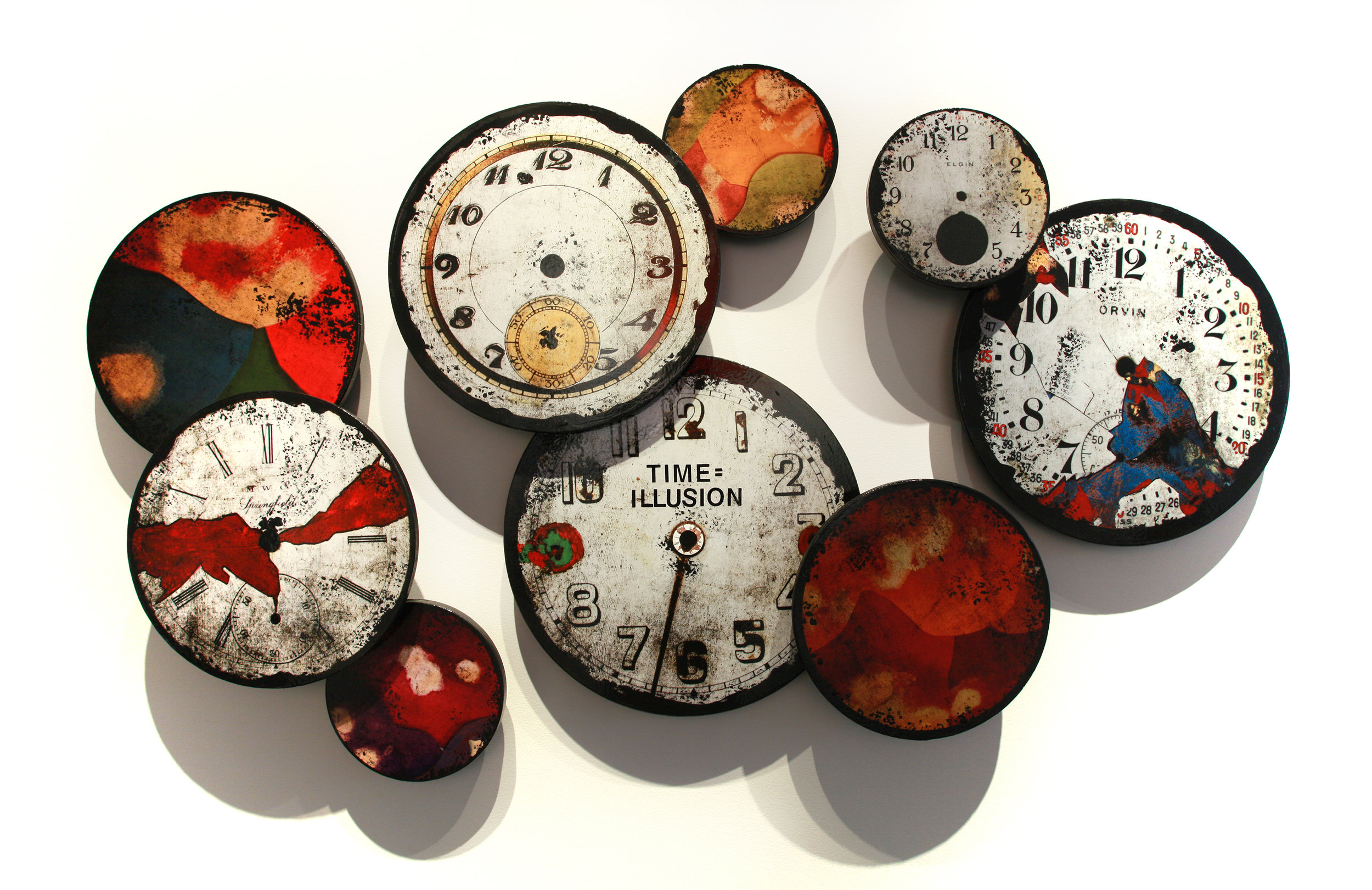 """Time = Illusion Installation, Mixed Media on 9 panels sized between 10"""" - 20"""" in diameter. As pictured here the installation is 41"""" x 69.75"""", 2016"""