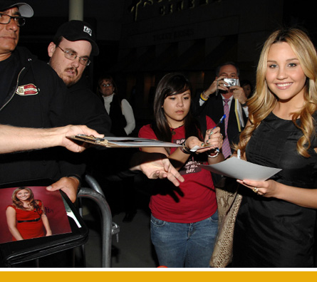 Amanda signs autographs for fans she hasn't mowed down yet.