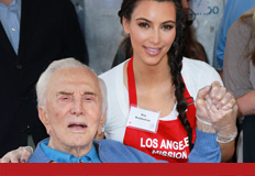 Here's Kim doing charity work/giving an old man an erection.