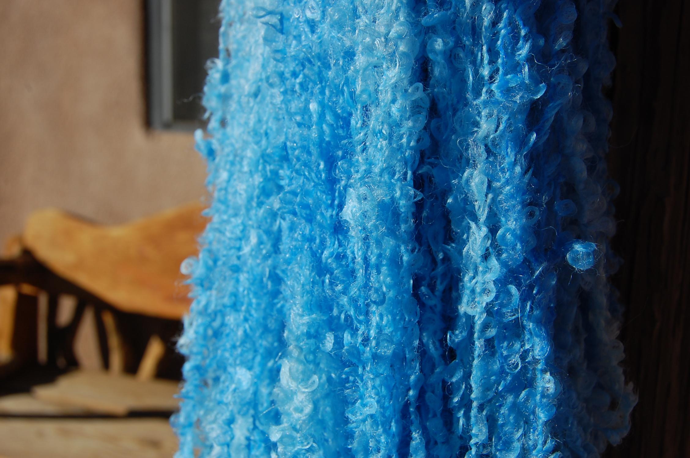 Turquoise blue yarn...