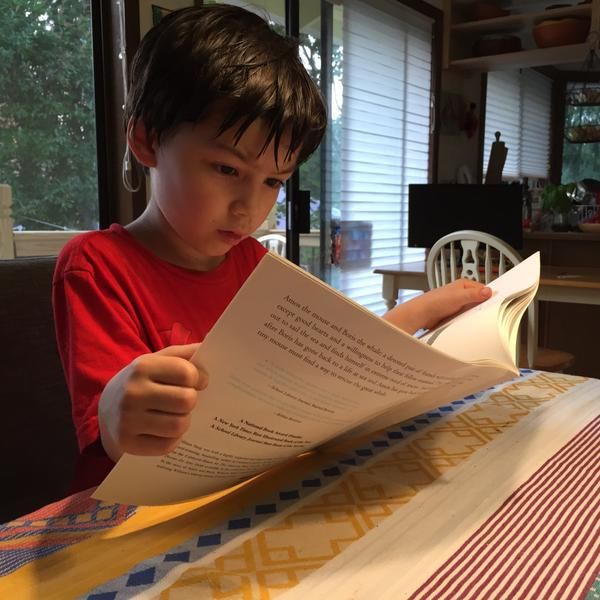Leo (age 5) has the Decade-A-Month subscription. In this photo, he's reading the eighth book he received, which was first published in 1971.
