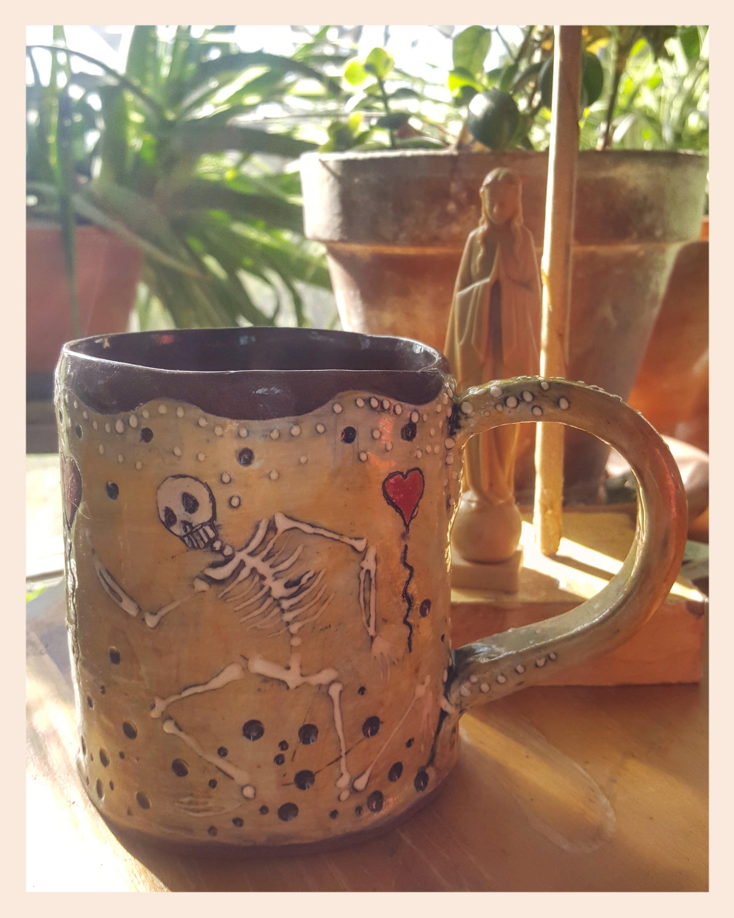 This is an amazing skeleton tea cup from  Sandra Civitarese of Pigasus Art Studio