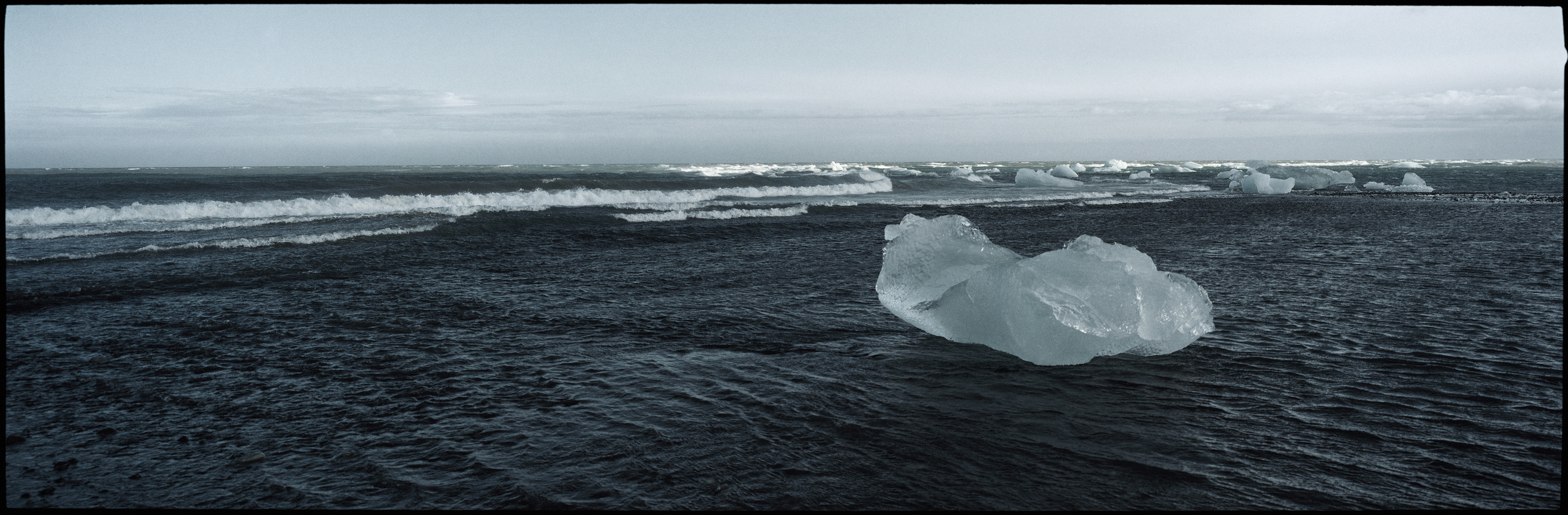 06.The Atlantic Ocean, washes back the icebergs drifting down from Jökulsárlón.