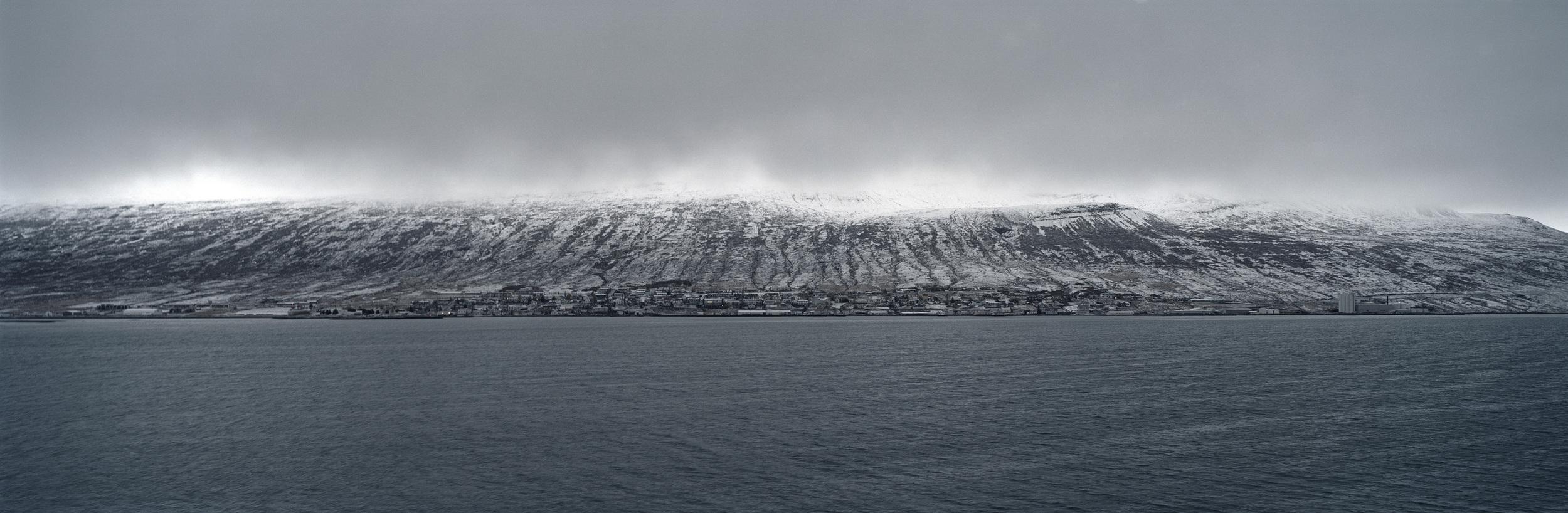 12.Village in the Southeast fjords, the town of Reyðarfjörður on the edge of twilight.