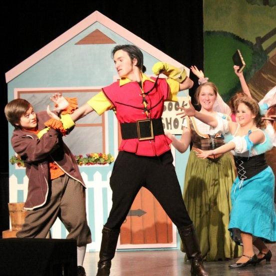 Gaston punching lefou.jpg