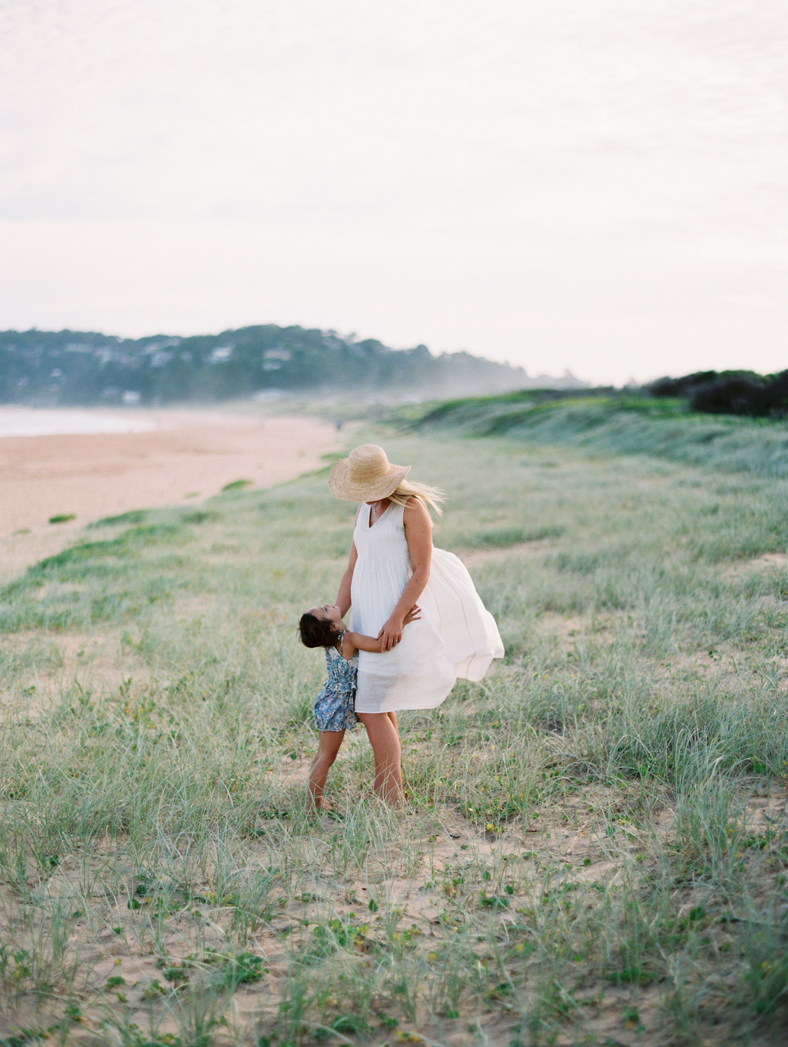 Family session on the beach, shot on film by Northern Beaches photographer, Kylie Mills