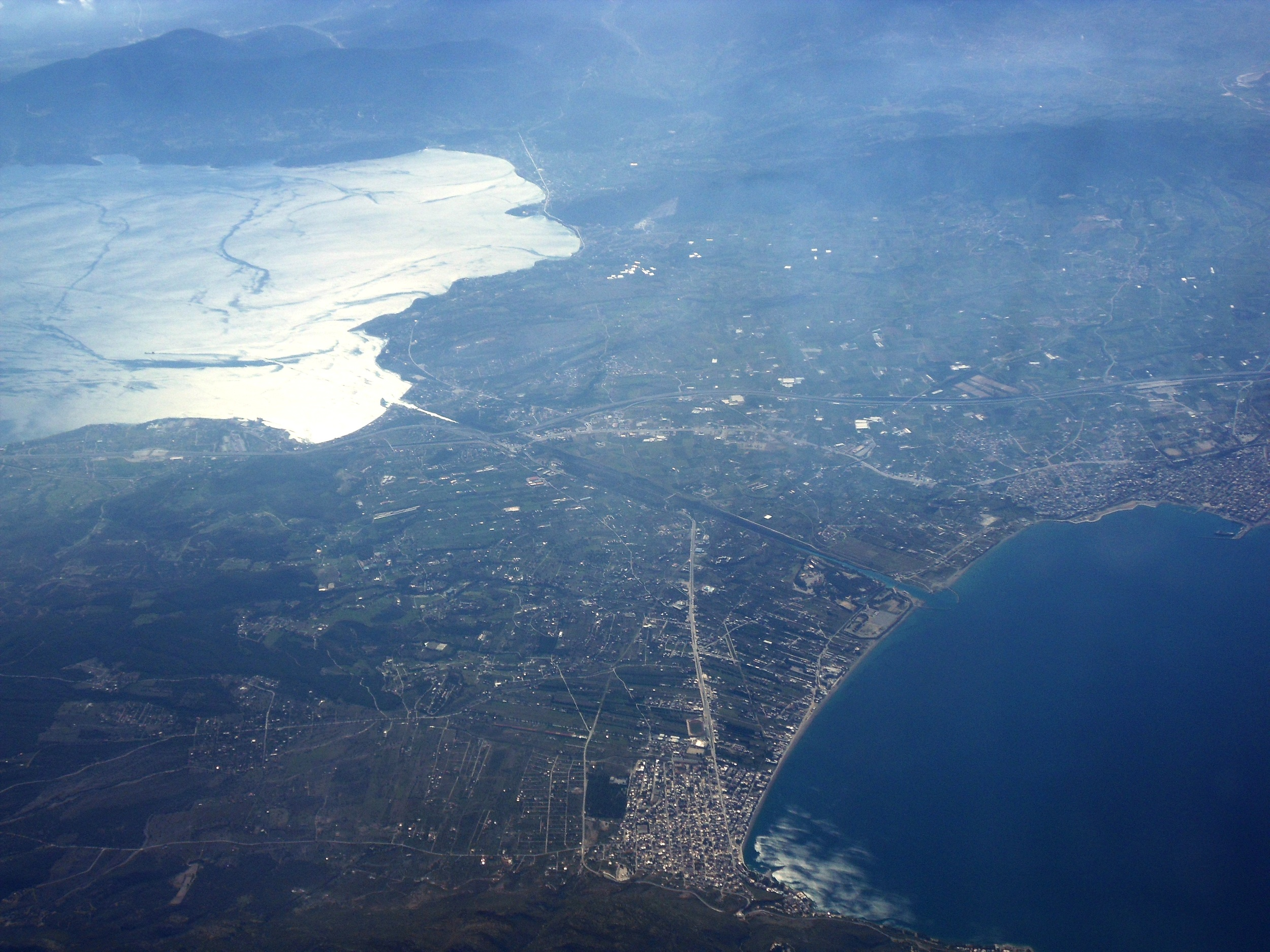 Another aerial shot of the canal and the Isthmus from further away. We entered from NW (Gulf of Corinth) and arrived SE (Saronic Gulf in the Aegean Sea).   Source:  Philos2000  via  Wikipedia