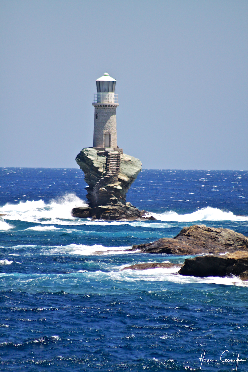 And I saved the best for last--there was a lighthouse off the little islet with the Venetian fort.  Combine strong Meltemi with a rough sea, add a lighthouse on the smallest rock imaginable and you get this spectacular challenger of nature.