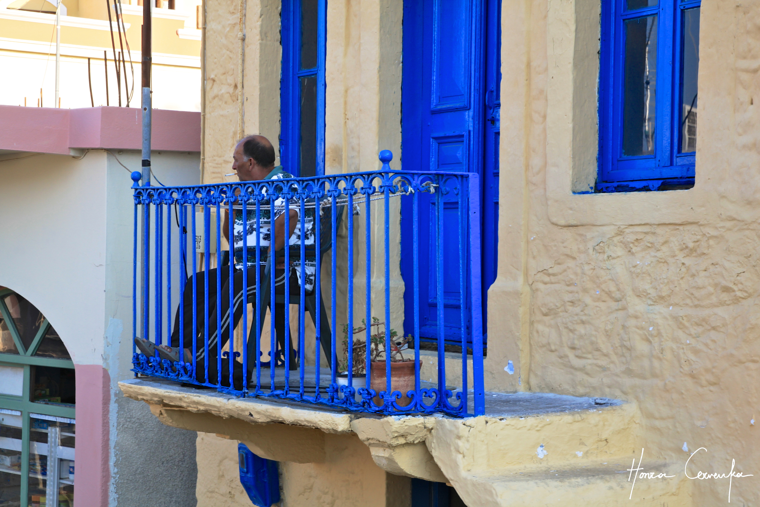 A typical Greek siesta--just make sure your railing is painted blue!