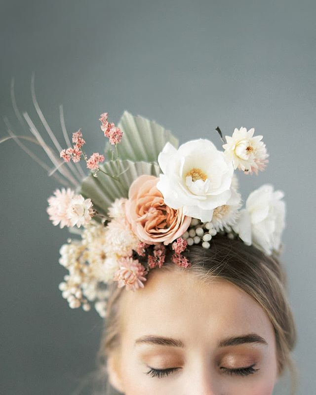 This is by far my favorite flower crown that I've ever seen.  Women of @nordandmae are geniuses at mixing dried flowers and tropical leaves with fresh blooms.  With dried flowers the crown was light as a feather, so our bride could easily wear the crown the whole day without it weighing on her head.  Design, styling and flower crown:  @nordandmae Makeup & hair: @hawelabeauty Venue: Musta Sali @fiskars_village . . . . . #häät #häät2019 #häät2020 #häät2021 #hääkuvaajat #hääkuvaus #stylemepretty #flowercrown #valokuvaajanaiset #naisyrittäjät #weddinginspiration #hääkuvausHelsinki #fiskars #mustasali #thatsdarling #pursuepretty #weddingflowers #weddingflorals #hääkukat #kukkaseppele #weddingflowerinspiration #bridetobe #fineartweddingphotographer #fineartwedding #modernweddings #nordicweddings #finlandweddingphotographer #destinationweddingphotographer #nordiskebryllup #destinationwedding