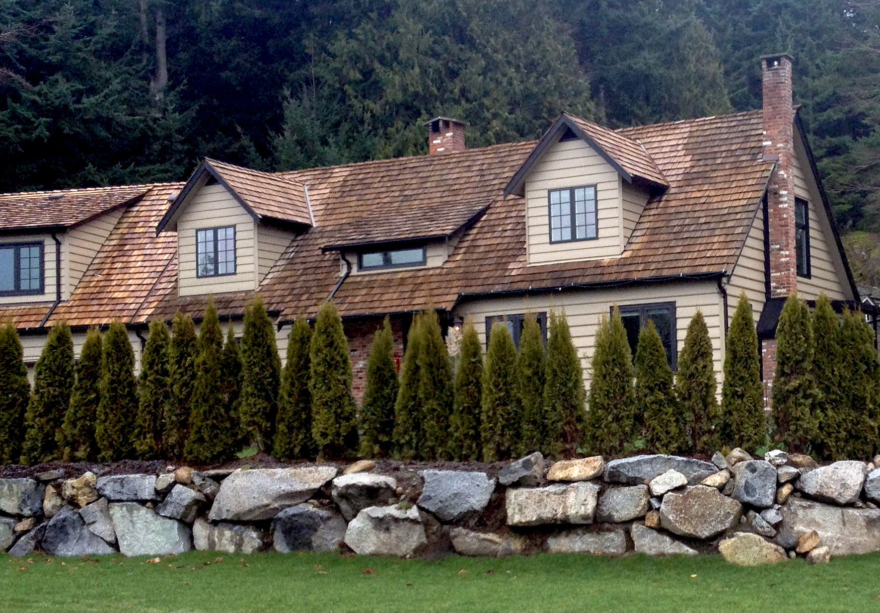Natural rock retaining wall in West Vancouver, BC