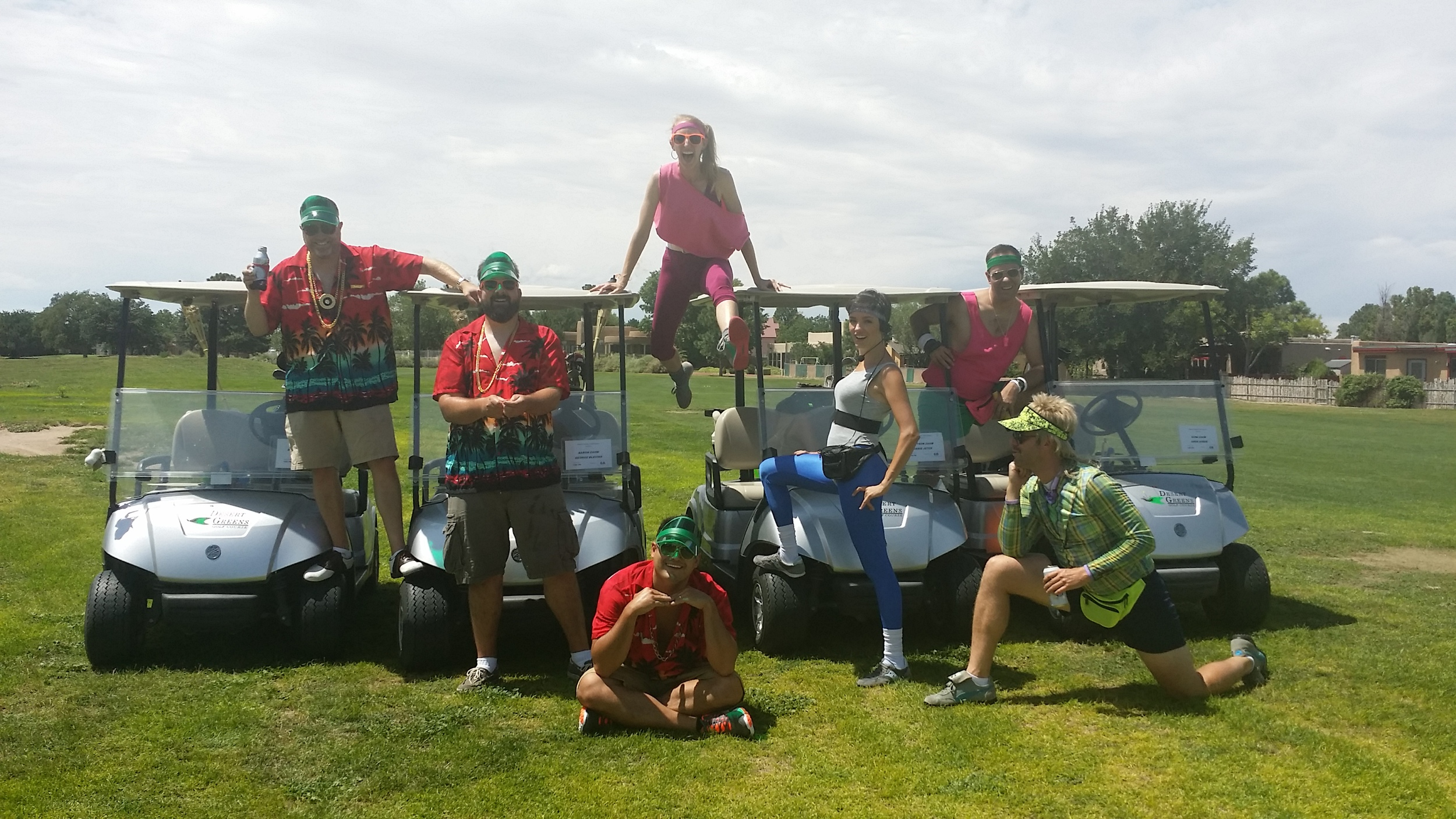 """Team """"Swingers"""" and Team """"Putts of Steel"""" take a break from golf. Putts of Steel took home the trophy for best costume."""