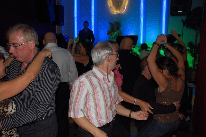 People Dance at one of the Social Dance Parties at Quick Quick Slow Ballroom Dance Studio