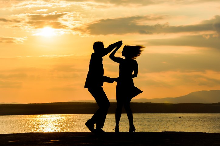 Dancing couple silhouettes in the sunset dance lessons inspire romace