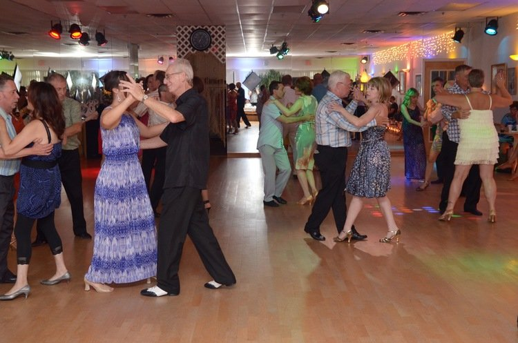 People enjoying dancing socially at one of the weekly practice dance parties at Quick Quick Slow