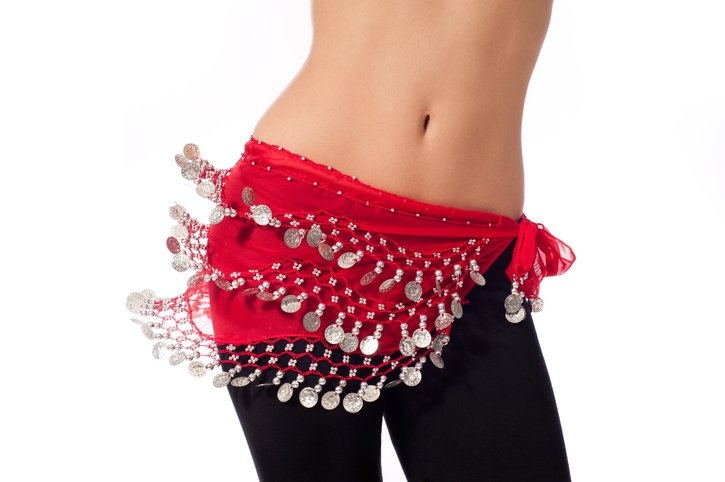 Woman in red coin belt shakes her hips