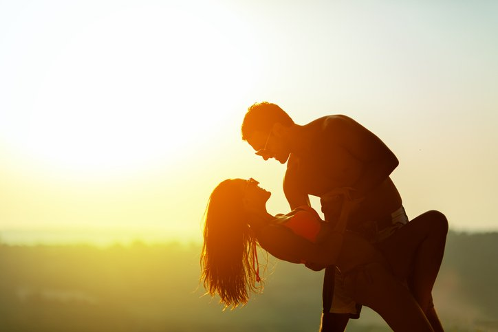 Couple enjoys a romantic dance at sunset after taking lessons